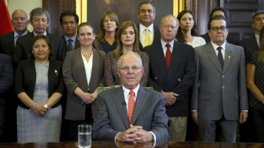 Pedro Pablo Kuczynski poses with his cabinet before addressing the nation and announcing his resignation.