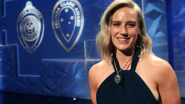Ellyse Perry with her medal after being named Australia's top female cricketer.