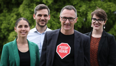 The Green's Brisbane performers - Kirsten Lovejoy (McConnel), Michael Berkman (Maiwar) and Amy McMahon (South Brisbane) with federal leader Richard Di Natale in the final days of campaigning last week.