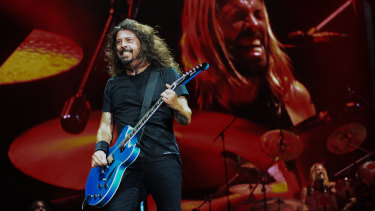 Dave Grohl and (background) Taylor Hawkins rock Suncorp Stadium.