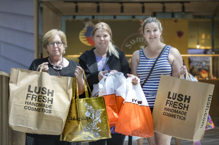 Anne Stewart, left, Phoebe Stewart and Jessica Solomon joined the crowd at the Canberra Centre looking for good Boxing Day buys.