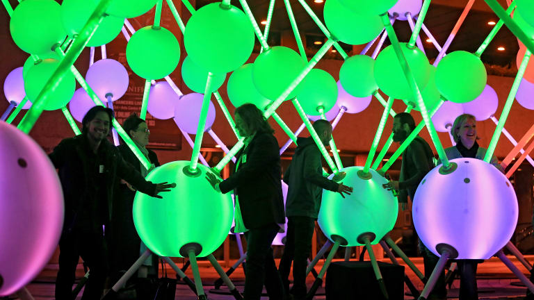 Affinity, a massive, interactive light sculpture representing neurons in the brain, is seen on the forecourt of the Arts Centre in Melbourne in 2015. The sculpture was commissioned by Alzheimer's Australia.
