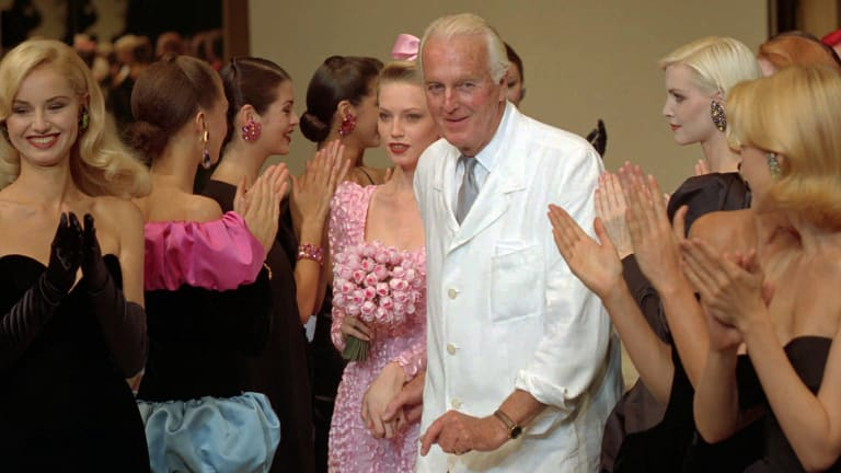 Hubert de Givenchy is applauded by his models after his 1995-96 fall-winter haute couture fashion collection in Paris.