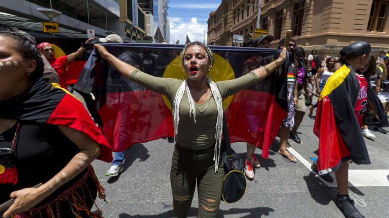 Protestors participate in an Invasion Day march in Brisbane on Friday.