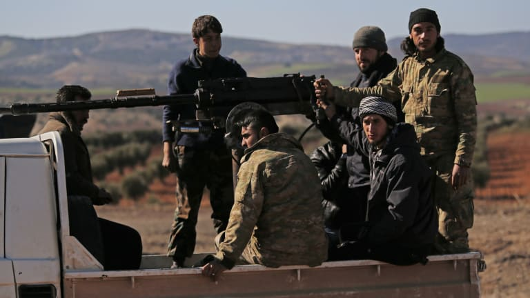 Beaten by the government and squeezed by al-Qaeda, many of Syria's rebels have put themselves under Turkey's wing to battle Kurdish forces, trying to find a path back to relevance in Syria's messy and multi-sided civil war.