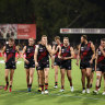 Essendon's players were sent an email on Friday night saying nine per cent of their wages would be withheld in November.
