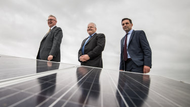 NSW Resources and Energy Minister Don Harwin (left),  John Schroder, CEO of Stockland Commercial Property  and Paul Peters, Verdia CEO, inspect solar panels on the rooftop at Stockland's Wetherill Park.