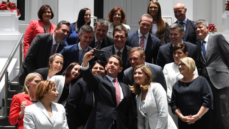 State Development Minister Cameron Dick (centre) takes a selfie with his fellow ministers at Government House.