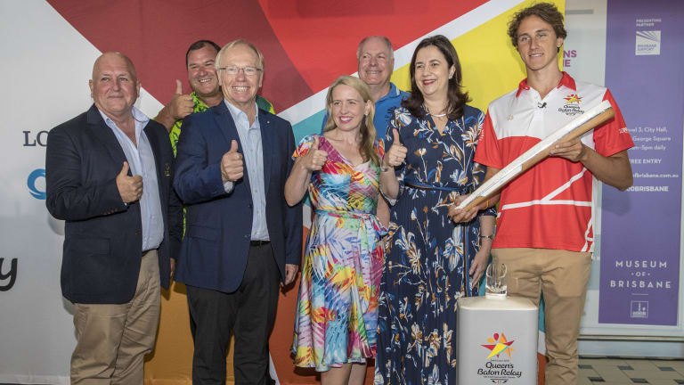 (From left) Commonwealth Games Australia CEO Craig Phillips, Cook Islands Commonwealth Games Federation Representative Hugh Graham, Gold Coast Commonwealth Games chairman Peter Beattie, Queensland minister for the Commonwealth Games Kate Jones, Gold Coast Commonwealth Games CEO Mark Peters, Queensland Premier Annastacia Palaszczuk and Swimmer Cameron McEvoy pose for a photograph with the Queen's baton at Brisbane International Airport on Saturday.
