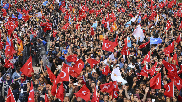 Supporters of Turkey's President Recep Tayyip Erdogan's ruling Justice and Development (AKP) Party, listen to his speech during a rally in Mersin, southern Turkey, on Saturday.