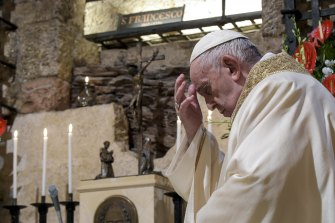 Pope Francis celebrates Mass in the crypt of the Basilica of St Francis, in Assisi, Italy, on Saturday, in his first trip outside of the Vatican for many months due to the pandemic.