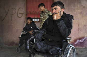 Syrian Democratic Forces soldier Swar Rojdam, 23, right, with fellow injured soldiers.