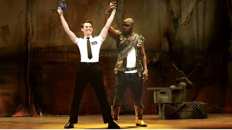 Ryan Bondy as Elder Price, and Augustin Aziz Tchantcho as The General in <em> The Book of Mormon</em>.