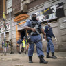 South African police and National Defence Force officers enforce a 21-day lockdown in Johannesburg.