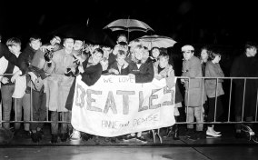 Young fans await the arrival of The Beatles at Sydney Airport on June 18, 1964.