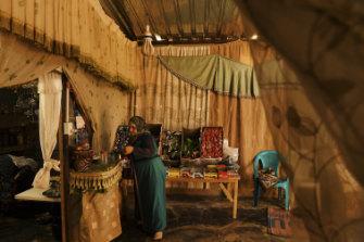 Samiha al-Kelani in the shop in the annex of her tent at Zaatari camp.