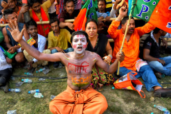 A man shows his support for Narendra Modi's party at a mass rally in Kolkata in April.