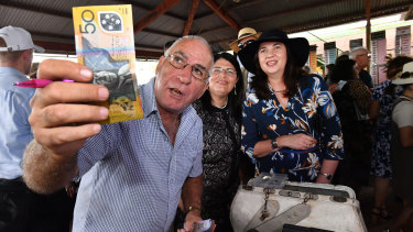 Racing Minister Grace Grace and Premier Annastacia Palasczcuk place a bet with bookmaker Trevor Byrnes at the Kumbia Race Club.