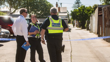 Police outside a Brunswick home where a woman's body was found.