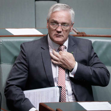 Nationals MP Damian Drum arrives for question time.