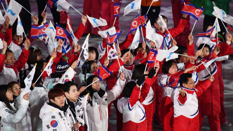 Athletes from North and South Korea enter the stadium for the closing ceremony of the PyeongChang 2018 Olympic Games.