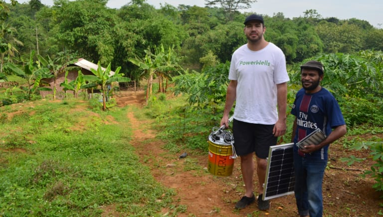 PowerWells co-founder Nick Kamols (left) with guide and translator Franz (right) who helped test the initiative in remote Indonesia.