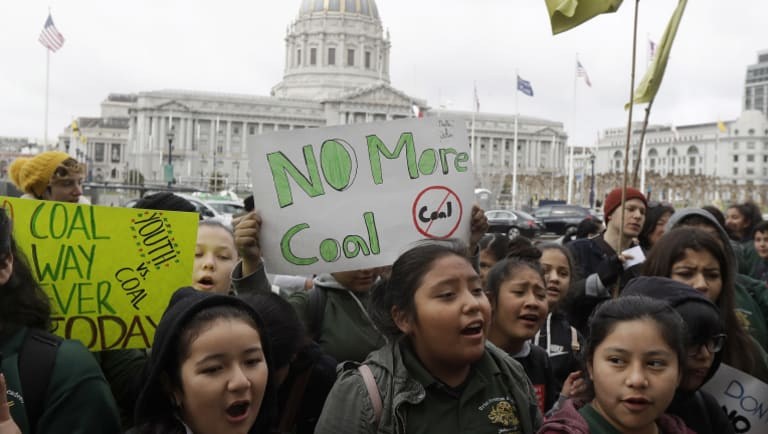 Students at a rally for clean energy in San Francisco last week. California opposes a Trump administration plan to scrap a policy slashing climate-changing emissions from power plants.