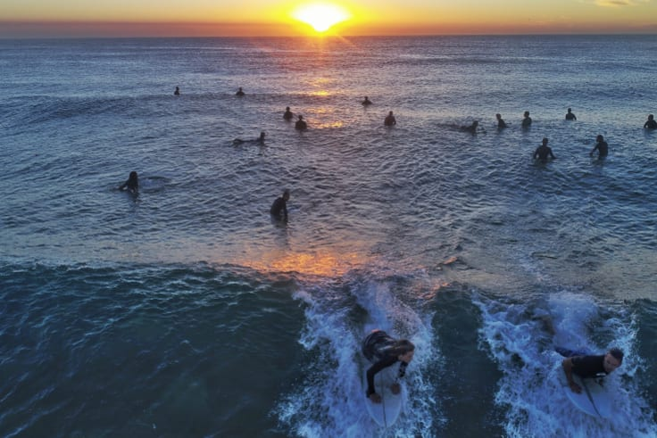 """The start of several days of large surf conditions or """"cyclone swell"""" are beginning to impact the NSW coast with surfers taking advantage at North Narrabeen on Friday."""