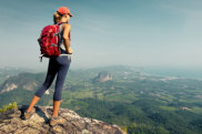 Woman hiker at top of mountain