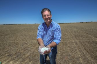 FYI Resources managing director Roland Hill holding a handful of kaolin at the site of their future Cadoux mine.