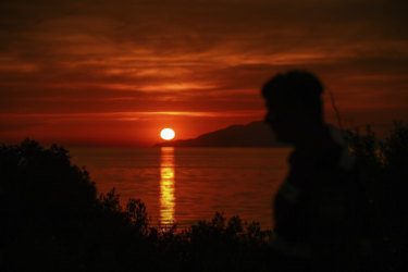 The sun sets as seen from the Anzac Cove beach in Gallipoli peninsula, Turkey on Tuesday