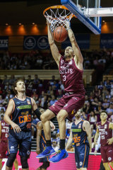 Brisbane centre Tom Jervis, pictured mid-slam dunk, was also instrumental for the Bullets.