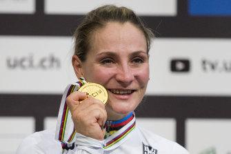 World champion Kristina Vogel of Germany holds her UCI gold medal.