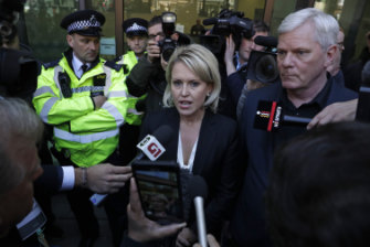 Jennifer Robinson with Wikileaks editor Kristinn Hrafnsson outside court on April 11.