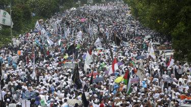 "Indonesian Muslims march in a 2016 rally against Jakarta's governor Basuki ""Ahok"" Tjahaja Purnama, a Christian."