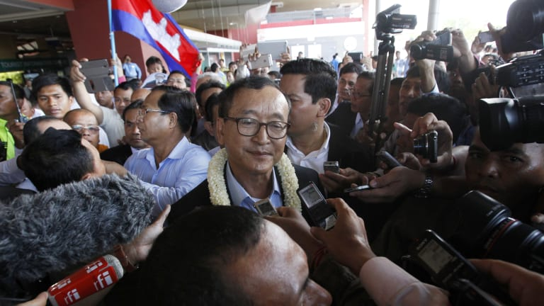 Former Cambodian opposition leader Sam Rainsy (centre) says Australia needs to do more to challenge the state of democracy in his homeland.