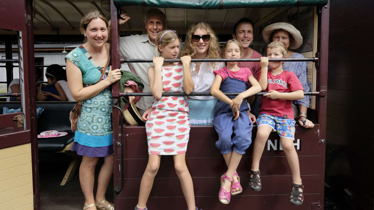 Michael Barnes with his son in law Marshall Bown and daughters Kylie and Alinta, his wife Trisha  and  their three grandchildren, Asher 5, Aruna 8, Yani 11, on the Puffing Billy train in January 2015.