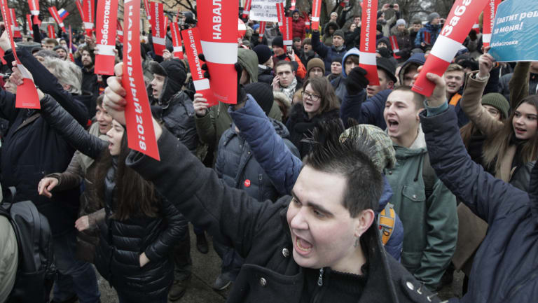 Protesters shout slogans during a rally holding posters reading 'Navalny 2018' against Russia's Central Election Commission's decision to ban the opposition leader Alexei Navalny presidential candidacy.