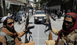 Taliban fighers patrol Kabul after reclaiming control of the capital.