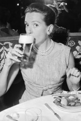 Actress Deborah Kerr drinks a beer at lunch at Romano's in Sydney on October 13, 1959. She was in Australia for the filming of The Sundowners.