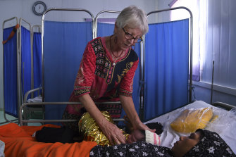 Kate Edmonds attends Fatima, 25, and her hours old baby at the Medecins Sans Frontieres hospital in Kutupalong Camp.