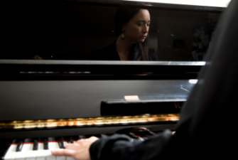 Screen composer Caitlin Yeo at the piano in her Marrickville home.