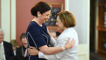 Queensland Premier Annastacia Palaszczuk (left) and Deputy Premier and Treasurer Jackie Trad embrace during the swearing-in ceremony at Government House.