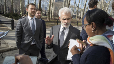 Bouchard's attorney Benedict Morelli talks to reporters.