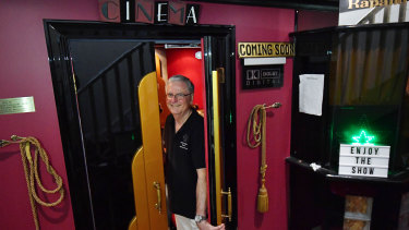 Labour of love: Retired flight attendant Chris Ball hosts free films for locals five nights a week from his Strathmore garage turned plush 14 seat cinema.