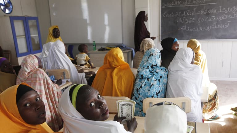 Children displaced by Boko Haram during an attack on their villages receive lectures in a school in Maiduguri, Nigeria in 2015. More young women have gone missing.