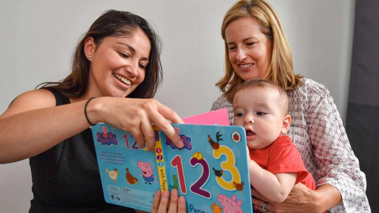 Virginia Zarama with her son Matias and Caring Mums volunteer Deb Broome.