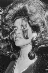 Lillian Frank: As well as her bouffant hair style she was wearing long, long false eye lashes.