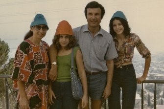 As a teenager (right) with parents Liz and Carl and sister Shellie in 1974.