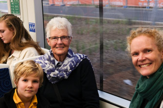 Margaret Langford (centre) with her grandson and daughter Kate Langford, (right).